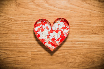 many red and white heart on a wooden background
