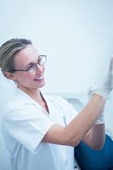 Dentist wearing surgical glove