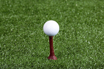 Golf ball on green grass outdoor close up