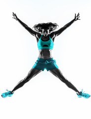 Fototapete - woman fitness jumping  stretching exercises silhouette