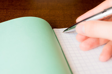 Pen and an exercise book, record in a notebook by pen