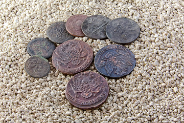 old copper coins in the sand