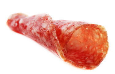 Slice of salami isolated on white background