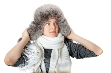 girl warmed in a cap and scarf. isolated