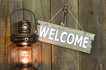 Welcome sign by antique lantern