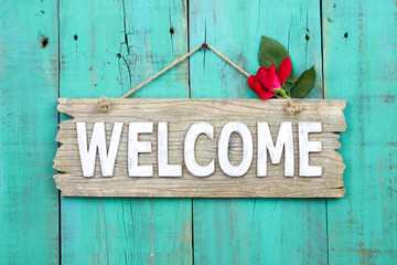Welcome sign with rose hanging on door Wall mural