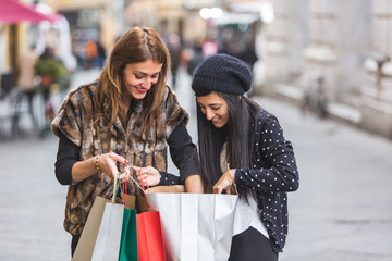 Happy Women with Shopping Bags in the City