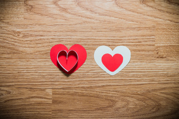 red and white heart on a wooden background