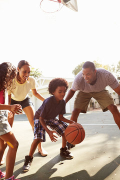 Family Playing Basketball Game At Home