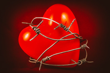 Heart in Barbed Wire on Red 1