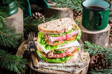 Coffee and homemade sandwich for lumberjack