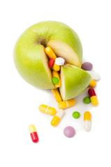 Natural green apple and various pills