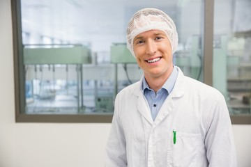 Happy pharmacist in a hairnet