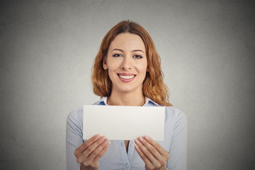 Excited woman showing empty blank paper card sign copy space