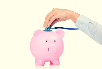 Piggy bank and Stethoscope Isolated white background