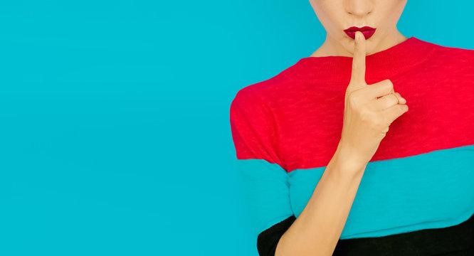 secret girl on blue background. Red lips trend