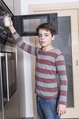 Child preparing a glass of milk