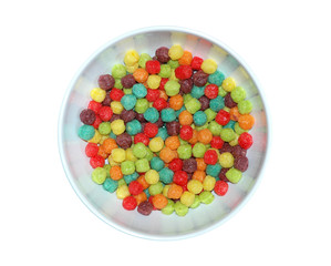 Colorful puffed cereal in bowl on white