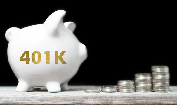 American retirement savings concept with piggy bank and coins ag