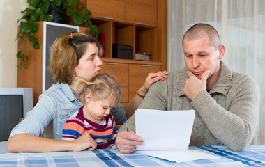 Worried family with financial documents