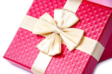 red gift box with gold ribbon.