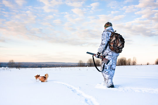 hunter with a dog on a frosty day