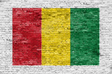 Reggae colors painted over brick wall