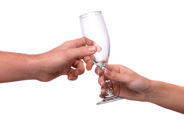 Hand giving a champagne flute