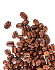 Brown coffee beans isolated on white background macro. Roasted C