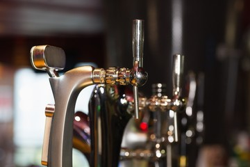 Beer pumps in a row