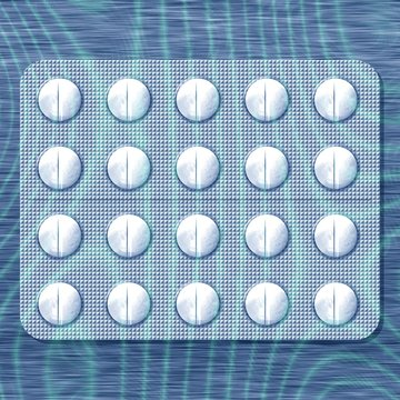White pills in soothing blue light