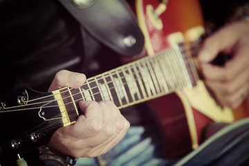 guitar player in vintage tone