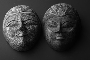Exquisitely painted masks, monochrome