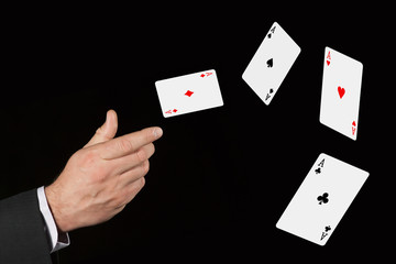 Flying cards is in the hand of lucky gambler