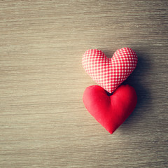 Red stuffed hearts over wood