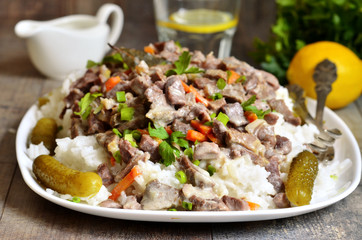 Beef Stroganoff with rice garnish.