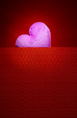 Pink heart with red background blank space for a Valentine's day