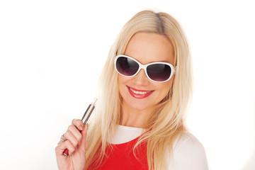 Pretty blond woman holding an e-cigarette