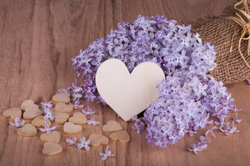 Lilac flowers with wooden heart.