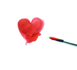 Painted red heart and a brush isolated over white