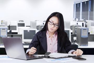 Modern entrepreneur working on desk in office