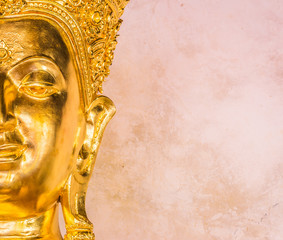 Closeup of the face of buddha's image .