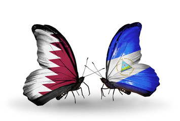 Two butterflies with flags Qatar and Nicaragua