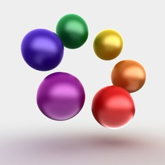 colorful glossy balls on gray