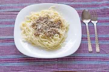 Italian spaghetti topped with bolognaise, or bolognese, sauce wi