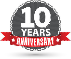 Celebrating 10 years anniversary retro label with red ribbon, ve