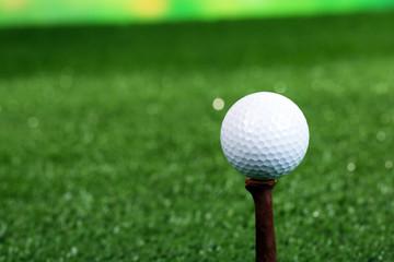 Golf ball on green grass outdoor close up