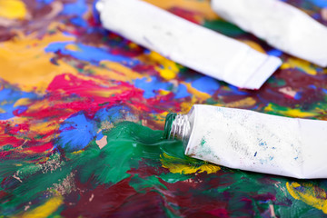 Colorful abstract paint strokes on canvas background