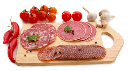 Various sliced salami with cherry tomatoes, chili pepper and