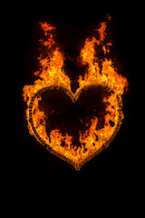Fire heart at night on black background